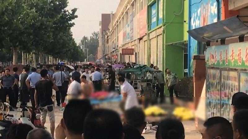 This screengrab taken from a broadcast by China's State broadcaster CCTV on June 15, 2017, shows the aftermath of an explosion outside a kindergarten in the eastern Chinese city of Xuzhou (AFP Photo)