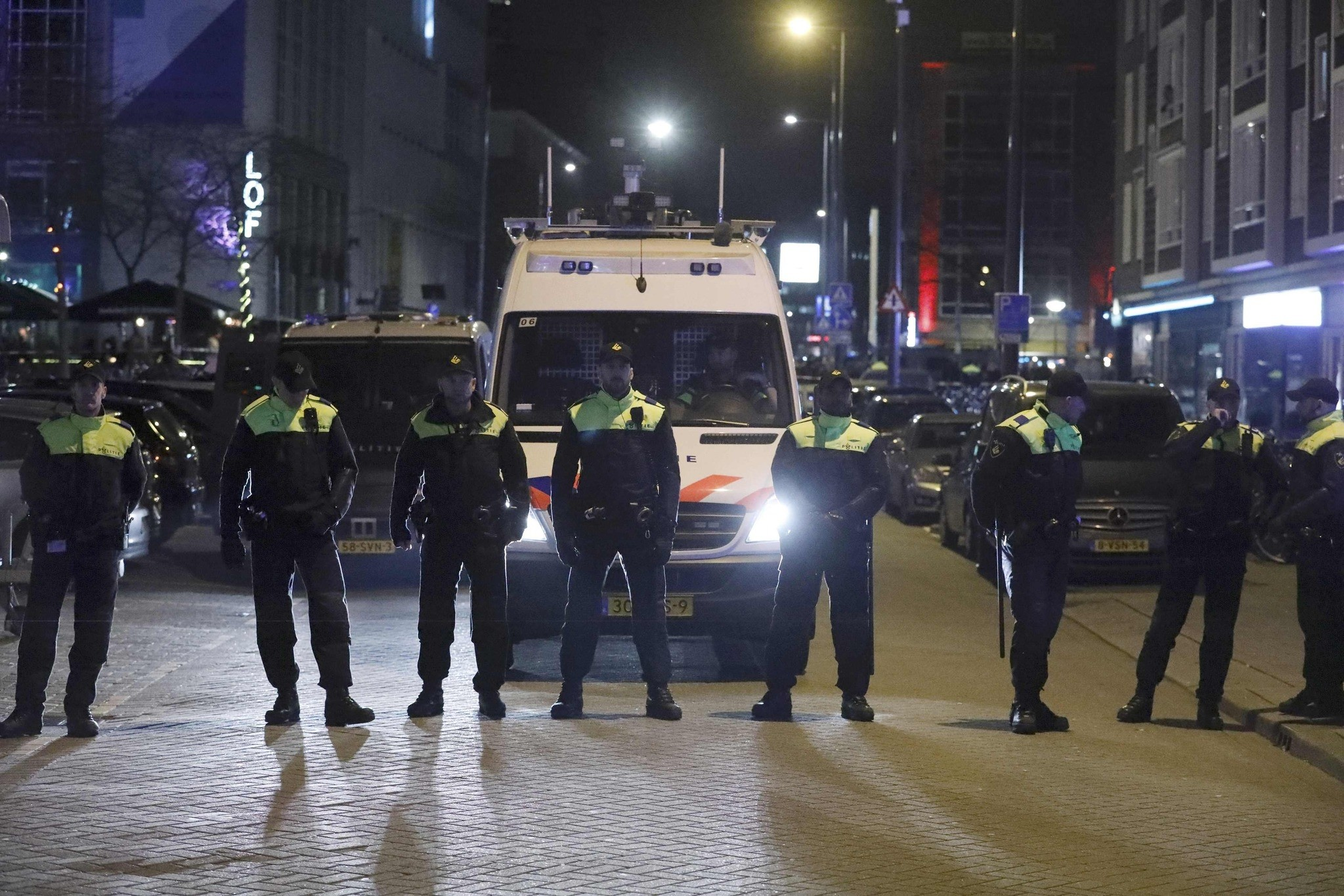 Police block off the street outside the Turkish consulate in Rotterdam where a crowd gathered to welcome the Turkish Family Minister Fatma Betul Sayan Kaya.