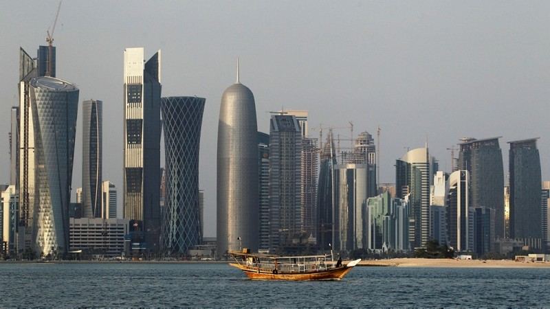 In this Thursday Jan. 6, 2011 file photo, a traditional dhow floats in the Corniche Bay of Doha, Qatar, with tall buildings of the financial district in the background. (AP Photo)