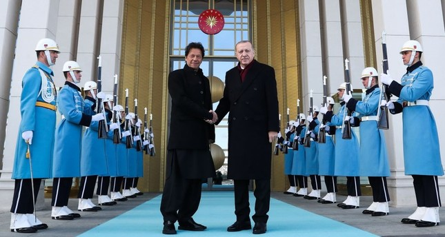President Recep Tayyip Erdoğan (R) welcoming Pakistan's Prime Minister Imran Khan (L) ahead of their meeting at the Presidential Complex in Ankara, on Friday.