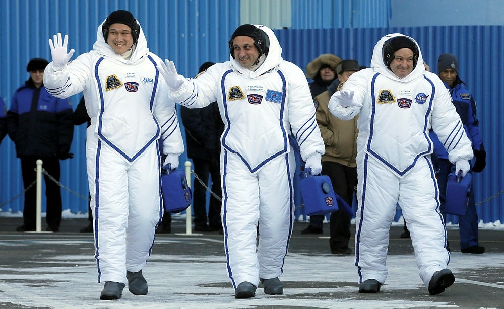 Members of the International Space Station expedition 54/55, Roscosmos cosmonaut Anton Shkaplerov (C), NASA astronaut Scott Tingle (R) and Norishige Kanai (L) of the Japan Aerospace Exploration Agency (JAXA) during the send-off ceremony. (EPA Photo)