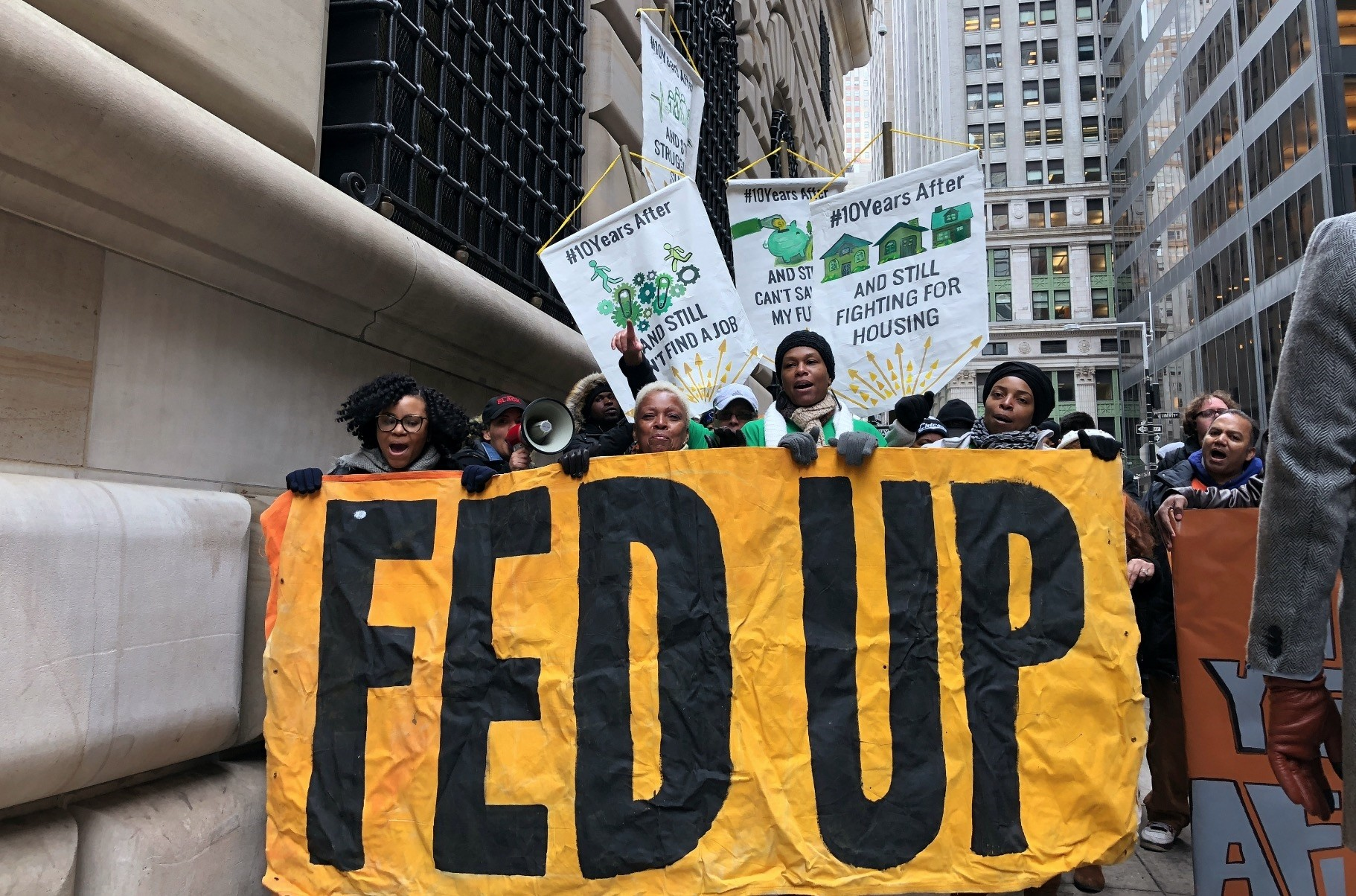 Community and labor activists led by the Fed Up coalition demonstrate and call for the selection of a Federal Reserve Bank of New York president independent from Wall Street, outside the Fed bank, New York.