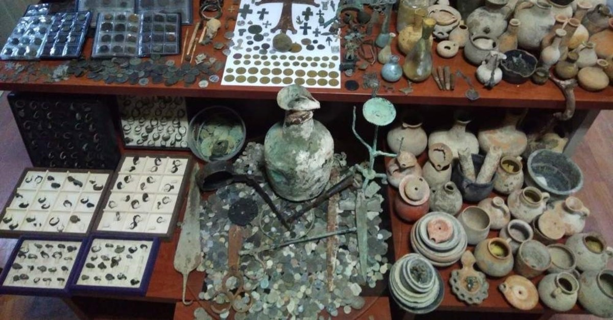 Police said a majority of the seized artifacts were ancient coins. (AA Photo)