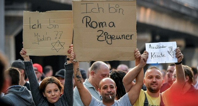 Demonstrators show their nationality at Breslauerplatz in Cologne, Germany, August 28, 2018. (EPA Photo)