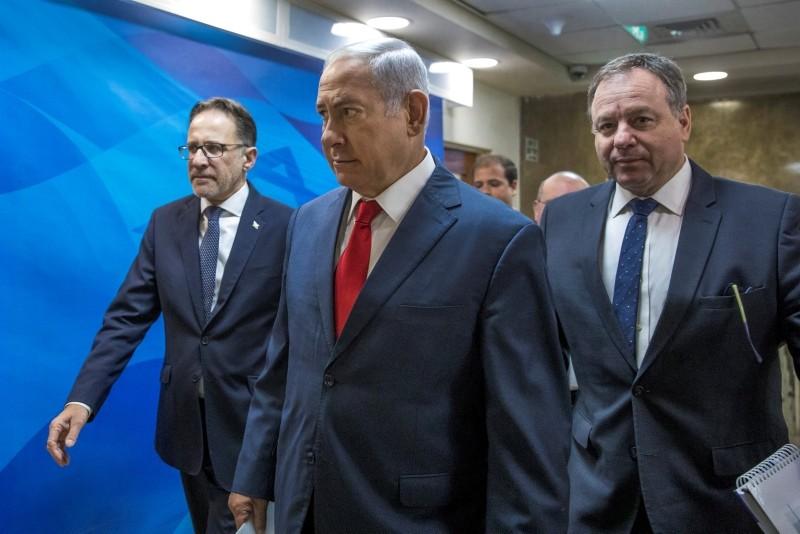 Israeli Prime Minister Benjamin Netanyahu arrives to the weekly cabinet meeting at his office in Jerusalem, August 12, 2018.  (Pool via Reuters)
