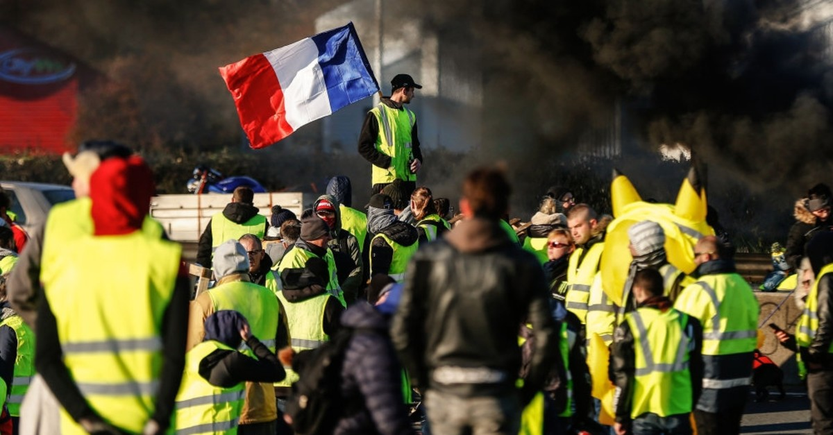 The ,yellow vests, protestors block a road during a demonstration againt the French government, Caen, France, Nov. 18, 2018.