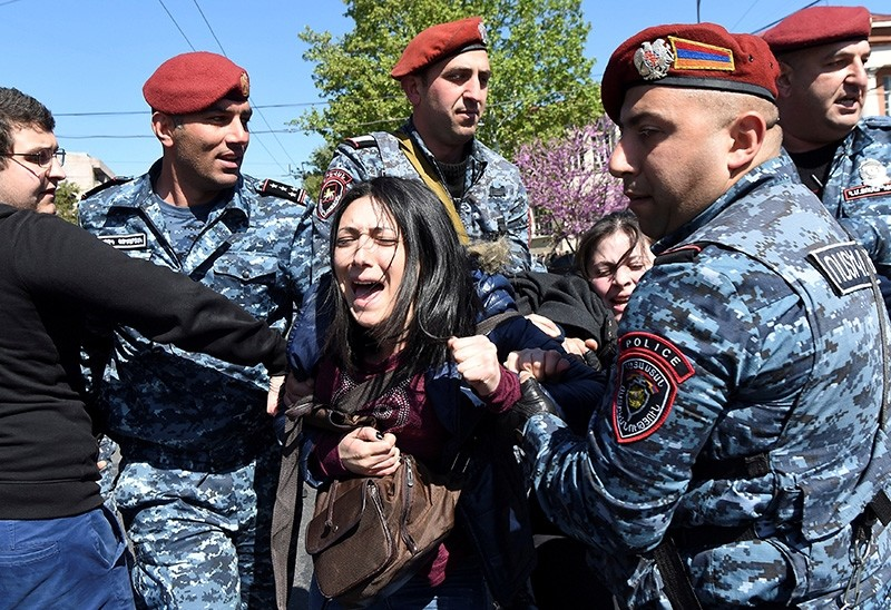 A demonstrator is detained by police during a protest against Armenia's ruling Republican party's nomination of former President Serzh Sarksyan as its candidate for prime minister, in Yerevan, Armenia (Reuters Photo)