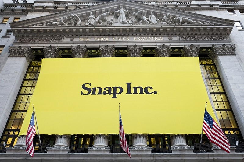 A banner for Snap Inc. hangs from the front of the New York stock exchange, Thursday, March 2, 2017, in New York. (AP Photo)