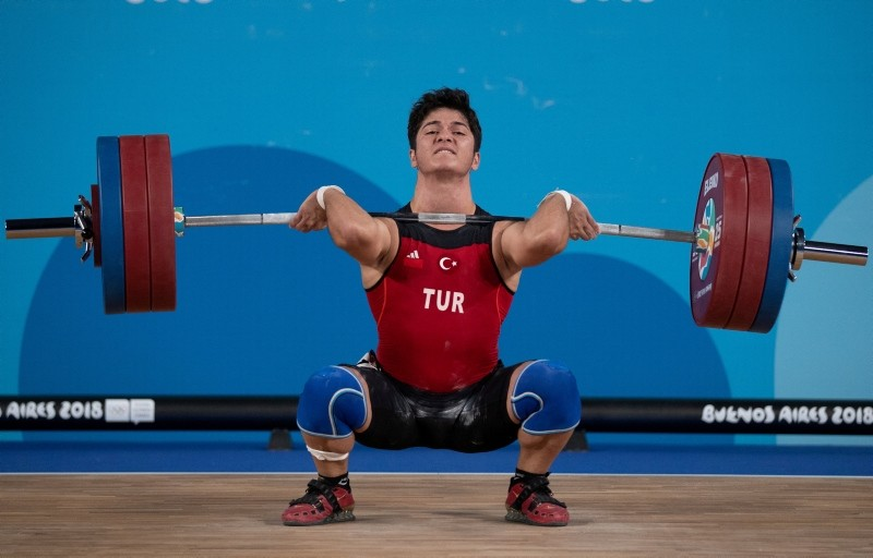 Muhammed Furkan u00d6zbek in action during the Men's 56kg weightlifting competition, Youth Olympic Park, Buenos Aires, Oct. 9. (Reuters Photo)