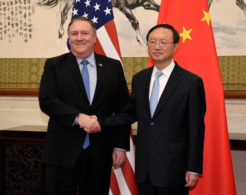 n this Monday, Oct. 8, 2018, file photo, U.S. Secretary of State Mike Pompeo, left, shakes hands with Yang Jiechi, a member of the Political Bureau of the Chinese Communist Party, before a meeting in Beijing. (AP Photo)