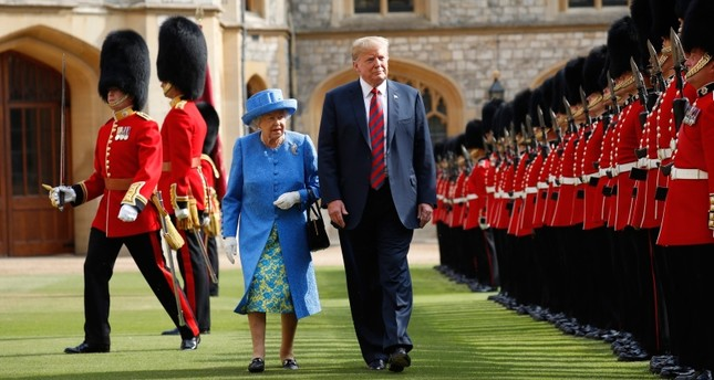 In this Friday, July 13, 2018 file photo, U.S. President Donald Trump and Britain's Queen Elizabeth inspects the Guard of Honour at Windsor Castle in Windsor, England. AP Photo