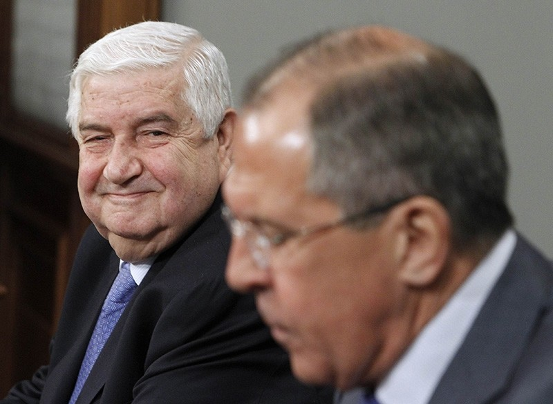 Walid al-Moualem (L) smiles during a joint press conference with Russian Foreign Minister Sergei Lavrov (R) in Moscow on April 10, 2012. (Reuters Photo).