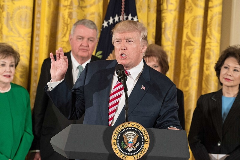 US President Donald Trump announces the Air Traffic Control Reform Initiative in the East Room at the White House in Washington, DC, on June 5, 2017. (AFP Photo)