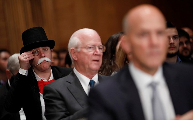 A hearing attendee looks on as Richard Smith, former chairman and CEO of Equifax, Inc., testifies before the U.S. Senate Banking Committee on Capitol Hill in Washington, U.S., Oct. 4, 2017. (Reuters Photo)