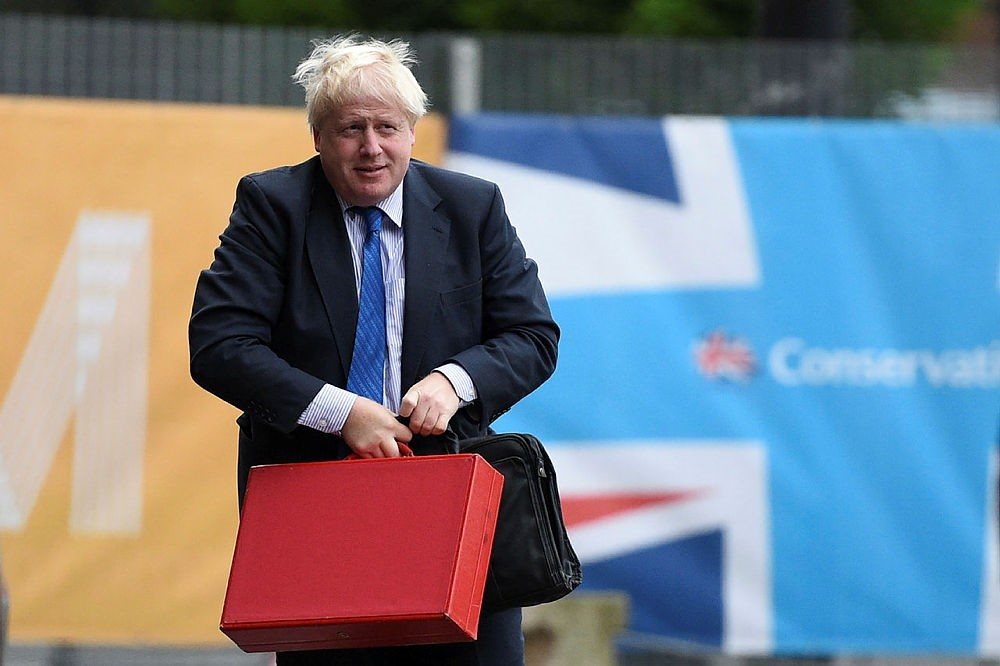 Britain's Foreign Secretary Boris Johnson arrives at the Midland Hotel on the first day of the Conservative Party, in Manchester on October 1, 2017. (AFP Photo)