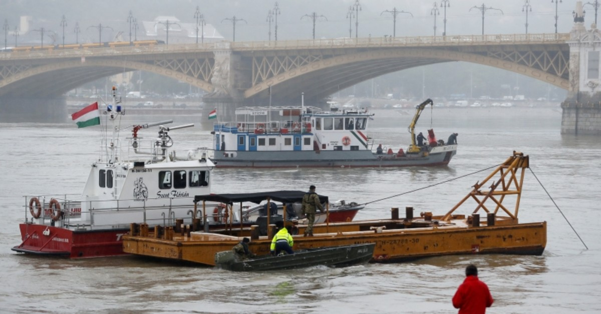 A person watches rescue boats after a ship accident that killed several people on the Danube river in Budapest, Hungary, May 30, 2019. (Reuters Photo)