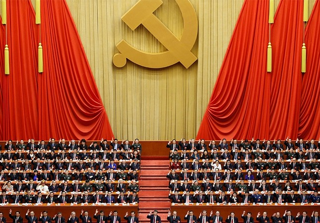 Chinese President Xi Jinping (front row, center) and fellow delegates raise their hands as they take a vote at the closing session of the 19th National Congress of the Communist Party of China, in Beijing (Reuters Photo)