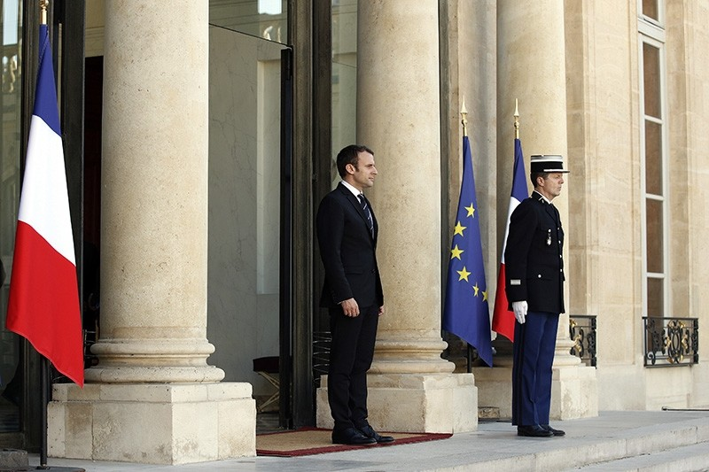 French President Emmanuel Macron waits to welcome UN Secretary General Antonio Guterres at the Elysee Palace in Paris, France, Tuesday, May 16, 2017 (AP Photo)