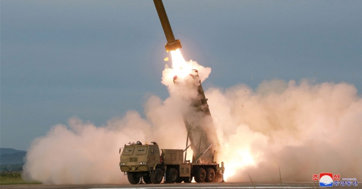 This picture taken on August 24, 2019 and released on August 25 by North Korea's official Korean Central News Agency (KCNA) shows the test-firing of a 'newly developed super-large multiple rocket launcher', at an undisclosed location. (AFP Photo)