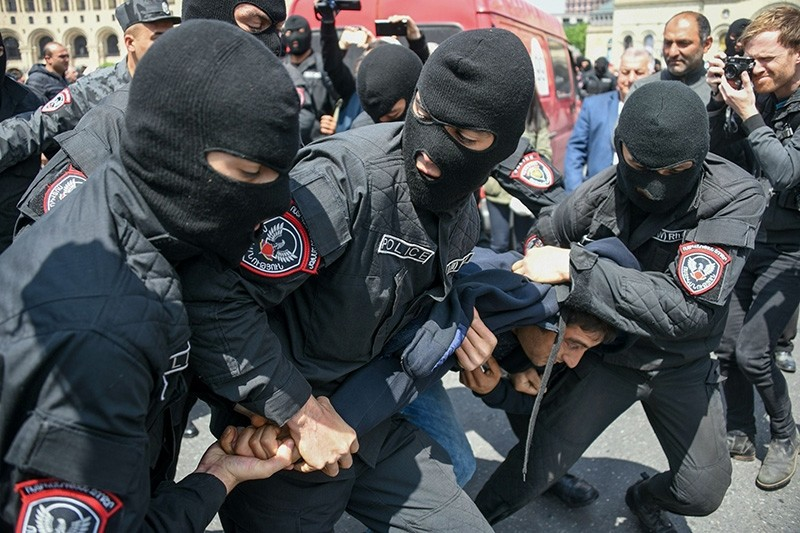Armenian policemen detain an opposition supporter during a rally in central Yerevan  (AFP Photo)