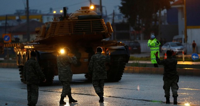 A Turkish military convoy arrives at an army base near the Turkish-Syrian border, Hatay province, Turkey, Jan. 17.