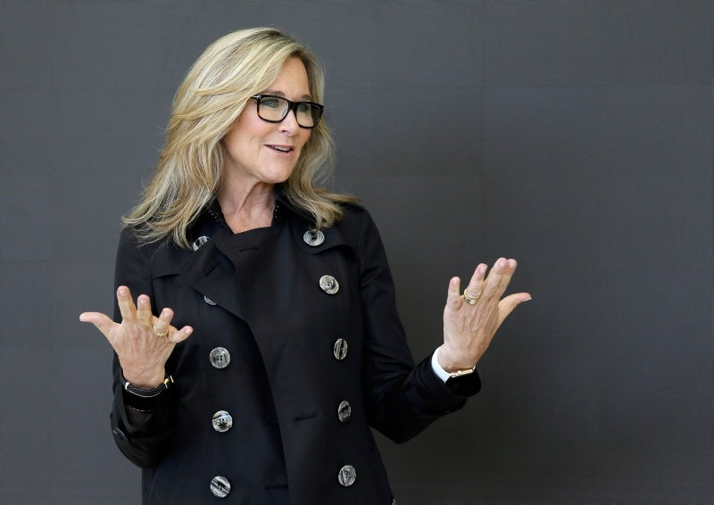 In this Thursday, May 19, 2016, file photo, Angela Ahrendts, Apple's senior vice president of Retail and Online Stores, speaks with reporters during a preview of the new Apple Union Square store in San Francisco. (AP Photo)