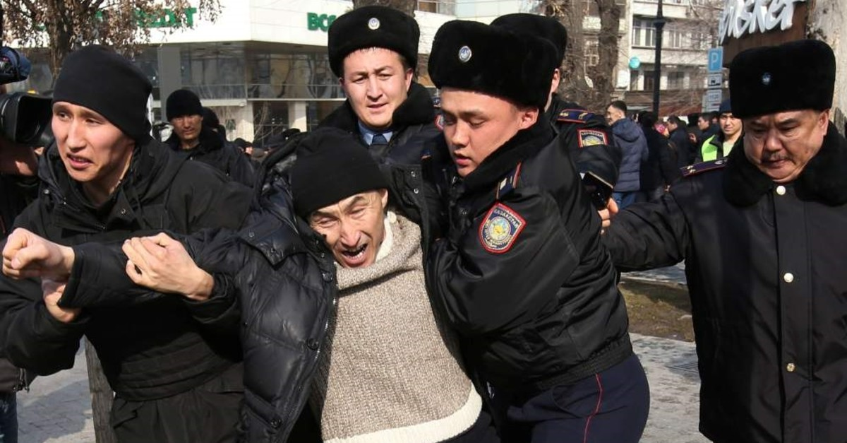 Kazakh law enforcement officers detain a protester during a rally held by opposition supporters in Almaty, Kazakhstan February 22, 2020 (Reuters Photo)