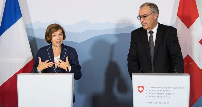 French Minister of the Armed Forces, Florence Parly, (L), next to Swiss Federal Councilor Guy Parmelin (R), speaks during a press conference near Bern, Switzerland. (EPA Photo)