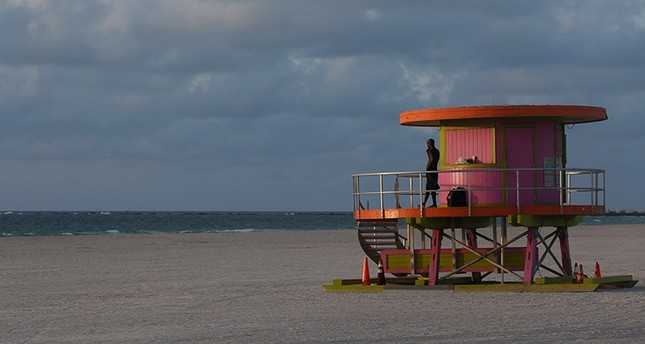 A person stands on a lifeguard stand at an empty South Beach, Friday, Sept. 8, 2017 in Miami Beach, Fla. (AP Photo)