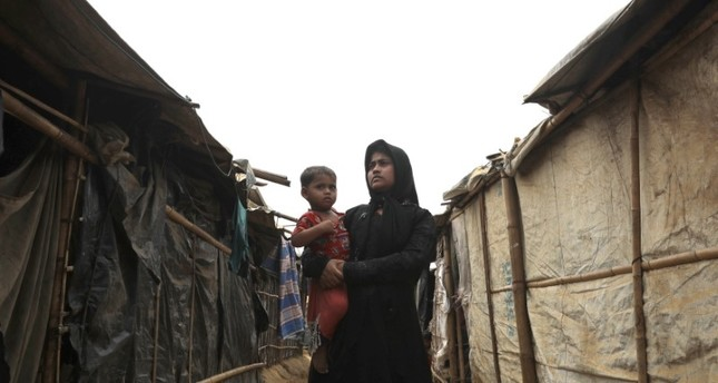 A Rohingya woman with her child at the Kutupalong camp, Cox's Bazar, Bangladesh, March 25.