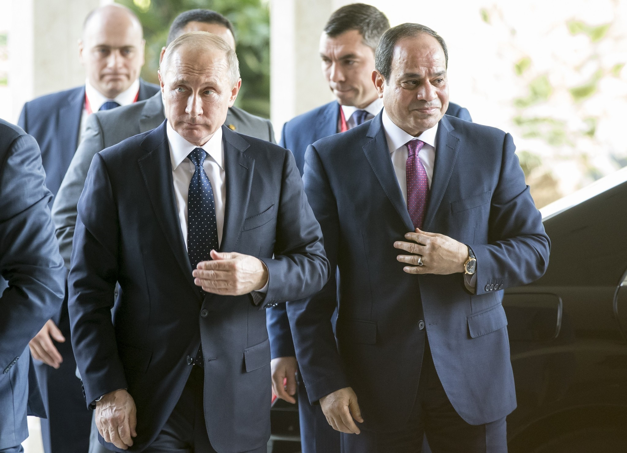 Egyptian president Abdel Fattah el-Sisi (R) welcomes his Russian counterpart  Vladimir Putin (L) prior to their meeting in Cairo on December 11, 2017. (AFP PHOTO)