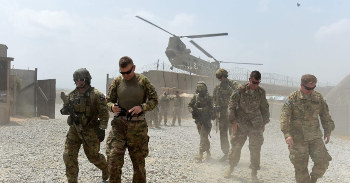 In this file photo taken on August 12, 2015 US army soldiers walk as a NATO helicopter flies overhead at coalition force Forward Operating Base (FOB) Connelly in the Khogyani district in the eastern province of Nangarhar. (AFP Photo)