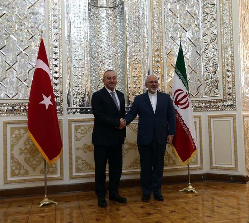 This file photo dated Dec. 17, 2014, shows Turkish FM Mevlu00fct u00c7avuu015fou011flu is being greeted by his Iranian counterpart Javad Zarif at the Foreign Ministry in Tehran, Iran. (AA Photo)