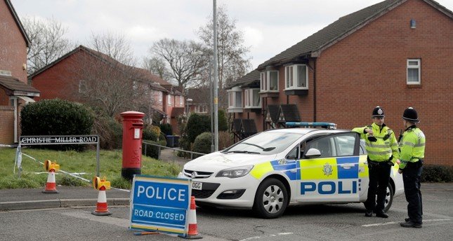 In this Tuesday, March 13, 2018 file photo, police officers stand guard at the bottom of the road where poisoned former Russian double agent Sergei Skripal lives in Salisbury, England. (AP Photo)