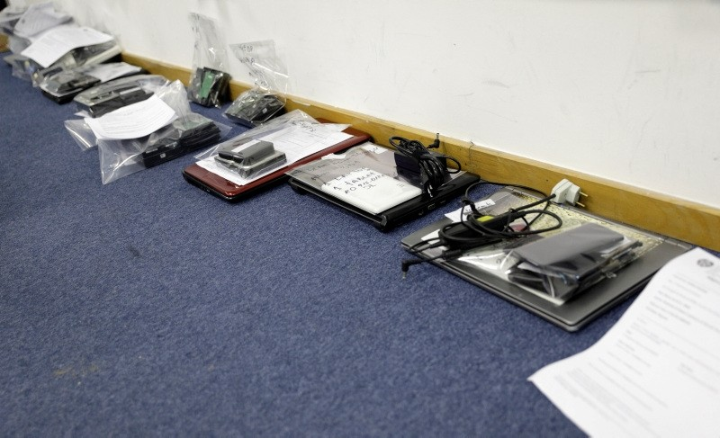 Computers and hard drives seized during operation against pedophilia, are seen at police station in Rio de Janeiro, Brazil May 17, 2018. (REUTERS Photo)