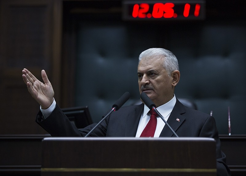 Prime Minister Binali Yu0131ldu0131ru0131m addresses Justice and Development Party (AK Party) lawmakers in the parliament, Ankara, Turkey, Oct. 17, 2017. (AA Photo)