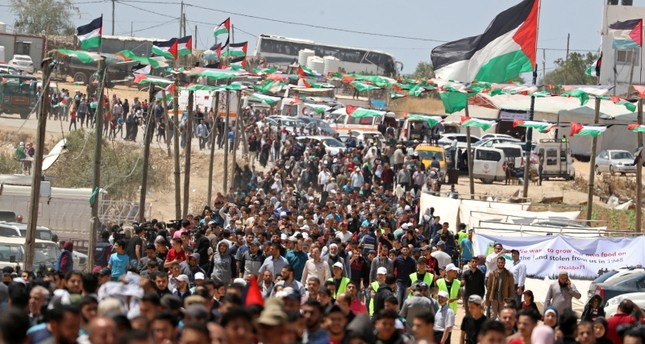 Palestinians gather to mark the 71st anniversary of the 'Nakba,' when hundreds of thousands were forced from their homes in the war surrounding Israel's independence in 1948, near the Israel-Gaza border, east of Gaza City, May 15, 2019. (Reuters)