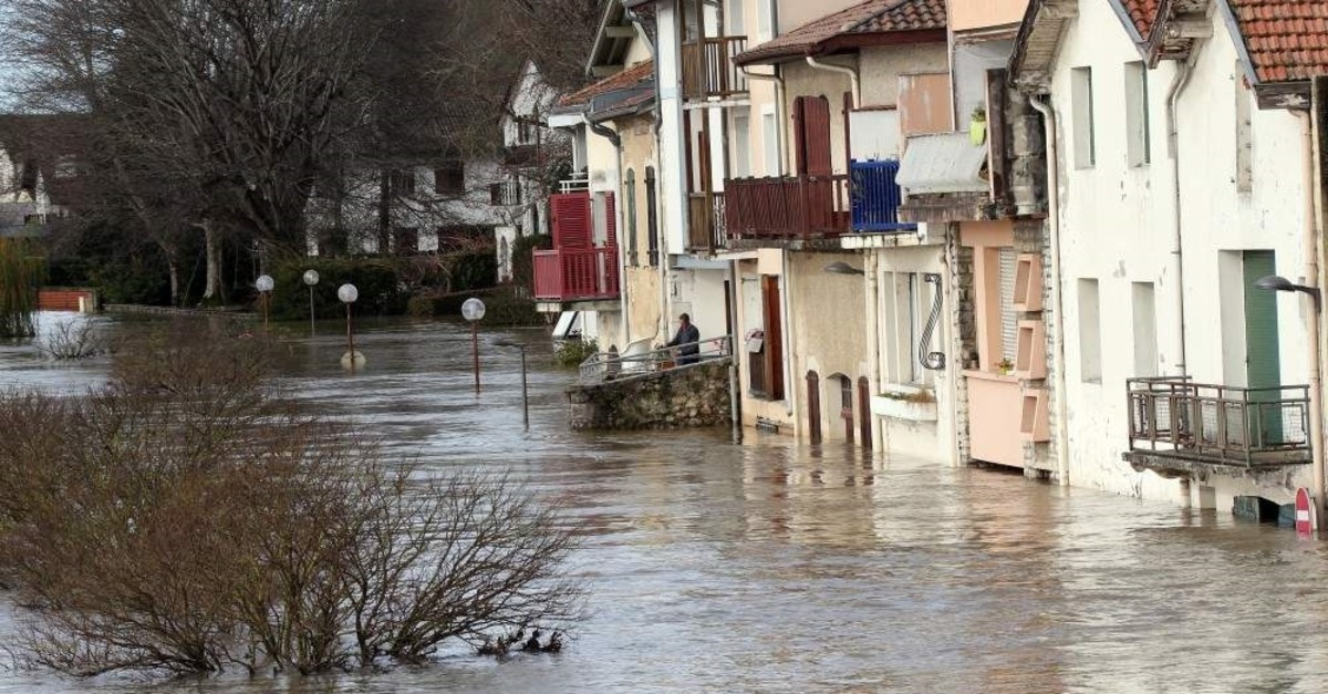 A view of flooded houses, in Peyrorade, southwestern France, caused by heavy rains. Southwestern France is on alert for violent storms, high winds and floods, Dec. 14, 2019 (AP Photo)