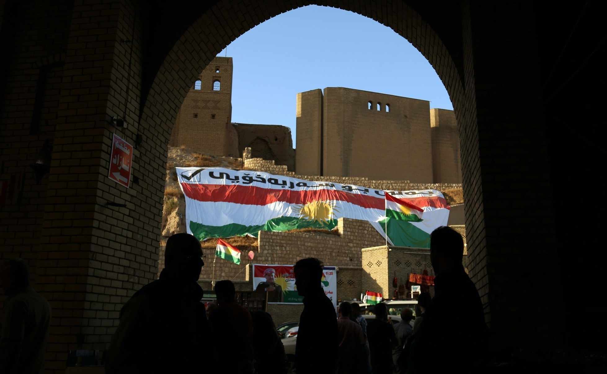 Iraqis walk in the square in the citadel in Irbil, the capital of the autonomous KRG in northern Iraq, just before the independence referendum, on Sept. 23, 2017. The voting induced an Iraqi offensive to take over contested areas.