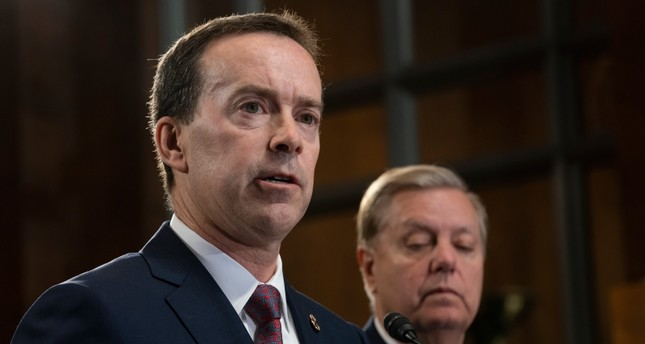 In this May 15, 2019, file photo, acting U.S. Customs and Border Protection Commissioner John Sanders, left, joins Senate Judiciary Committee Chairman Lindsey Graham, R-S.C., right, on Capitol Hill in Washington. U.S. (AP Photo)