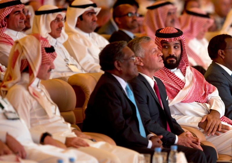Saudi Crown Prince, Mohammed bin Salman, right, looks at Saudi billionaire Prince Alwaleed bin Talal, left, while seated next to Jordan's King Abdullah II, during the Future Investment Initiative conference, in Riyadh, Saudi Arabia. (AP Photo)