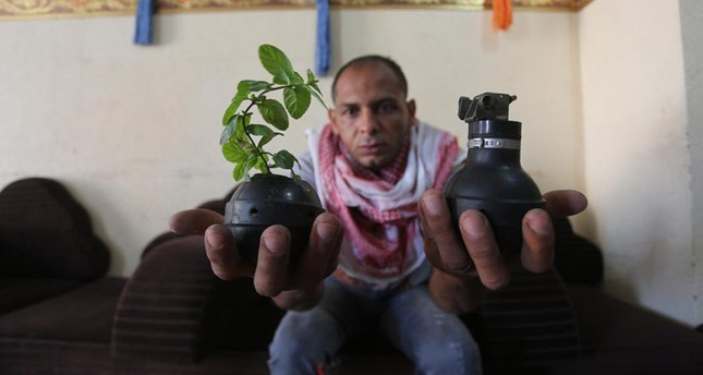 Abdul Karim Abu Ataya of Gaza transforms gas canisters and bombs into prayer beads and flower pots. (Photo by Mohammed Asad of Middle East Monitor)