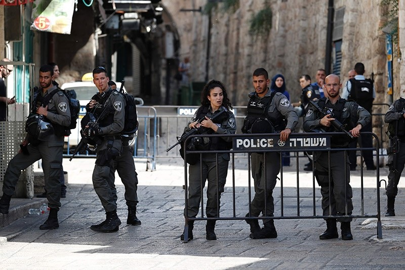 Israeli security forces stand guard at one of the entrances to Al Aqsa mosque compound in the Jerusalem's Old City on July 14, 2017. (AFP Photo)