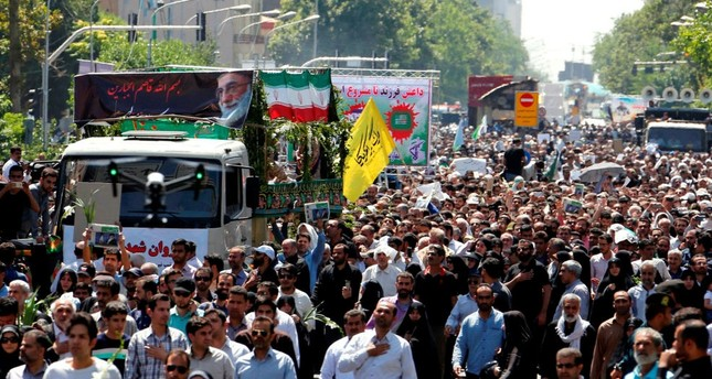 Iranians march during the funeral of the victims of the twin attacks in the capital Tehran on June 9.