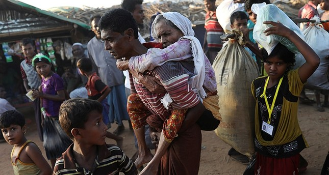 Rohingya Refugee Suray Khatun 70 Is Carried By Her Son Said A