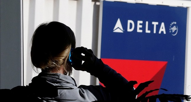 A passenger talks on her phone at a Delta Airlines gate a day before the annual Thanksgiving Day holiday at the Salt Lake City international airport, in Salt Lake City, Utah November 21, 2012. (Reuters Photo)
