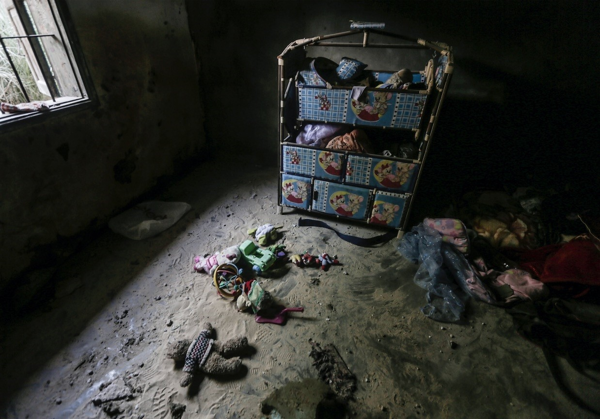 The photograph  shows the damage that Israeli airstrikes did to the house of the Khammash family in Deir Al Balah town in the central Gaza Strip on Thursday.