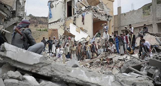In this Aug. 25, 2017 file photo, people inspect the rubble of houses destroyed by Saudi-led airstrikes in Sanaa, Yemen. (AP Photo)