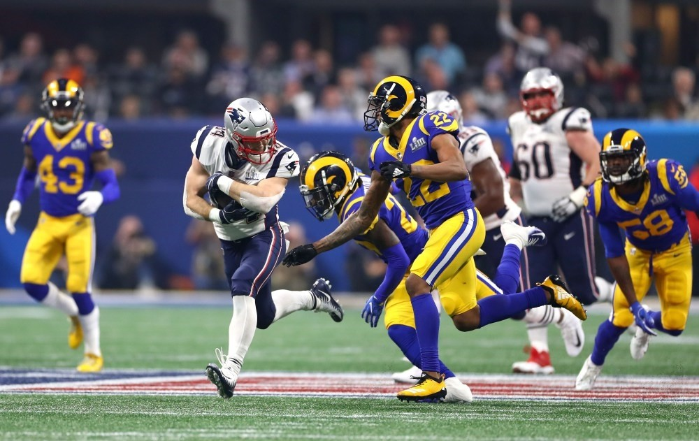 Rex Burkhead of the New England Patriots carries the ball against Marcus Peters of the Los Angeles Rams during the Super Bowl in Atlanta, Feb. 3, 2019.