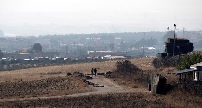 الحدود السورية كما تبدو من الجانب الإسرائيلي (EPA)